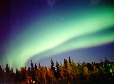 At its least active, the auroral curtain forms diffuse, glowing streaks hanging quietly in the sky. This form has no distinct structure. photo by Jan Curtis