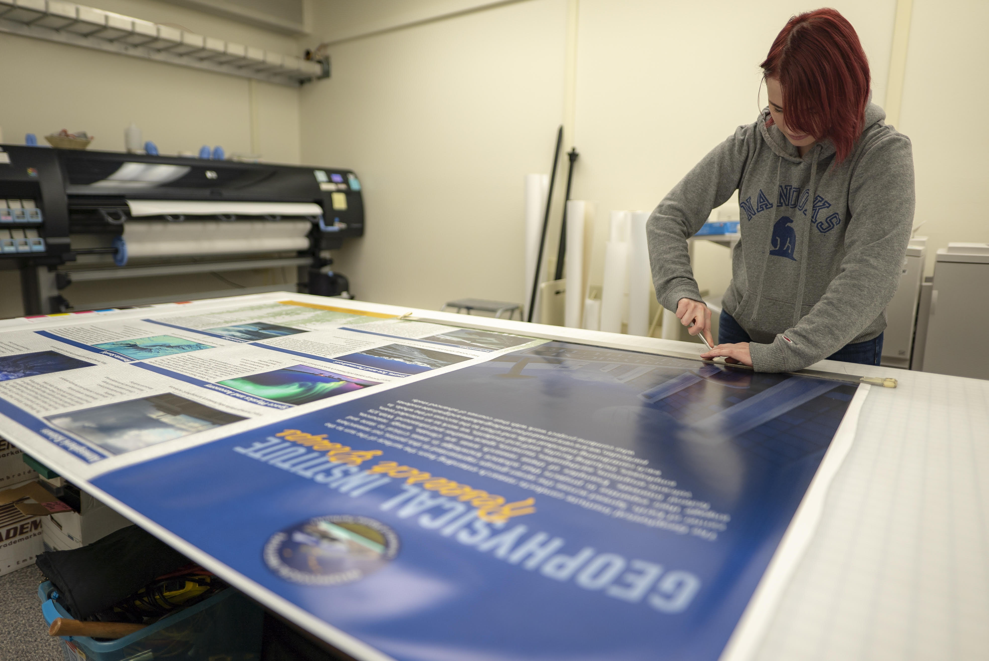 GI poster being printed in Design Services