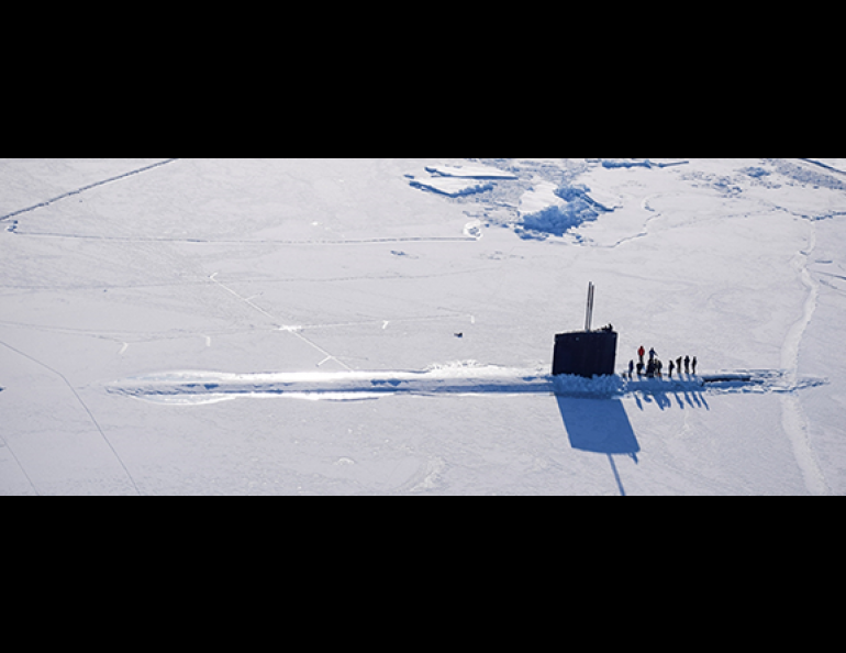 A submarine surfaces through the Arctic Ocean sea ice during a previous naval Ice Exercise. Photo courtesy of Arctic Submarine Lab