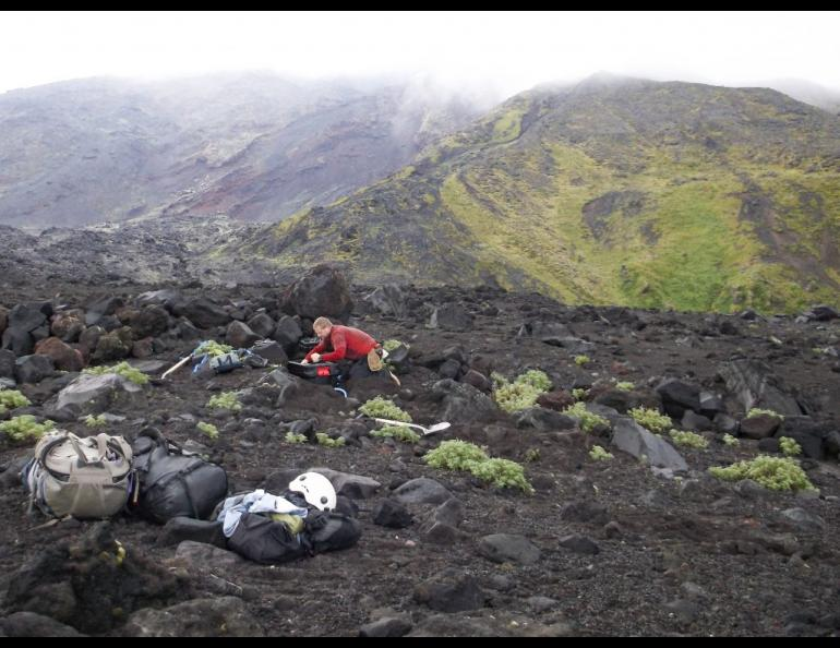 Pete Stelling, formerly of Western Washington University, assembles a seismic station on Cleveland Volcano in August 2015. Photo by Diana Roman.
