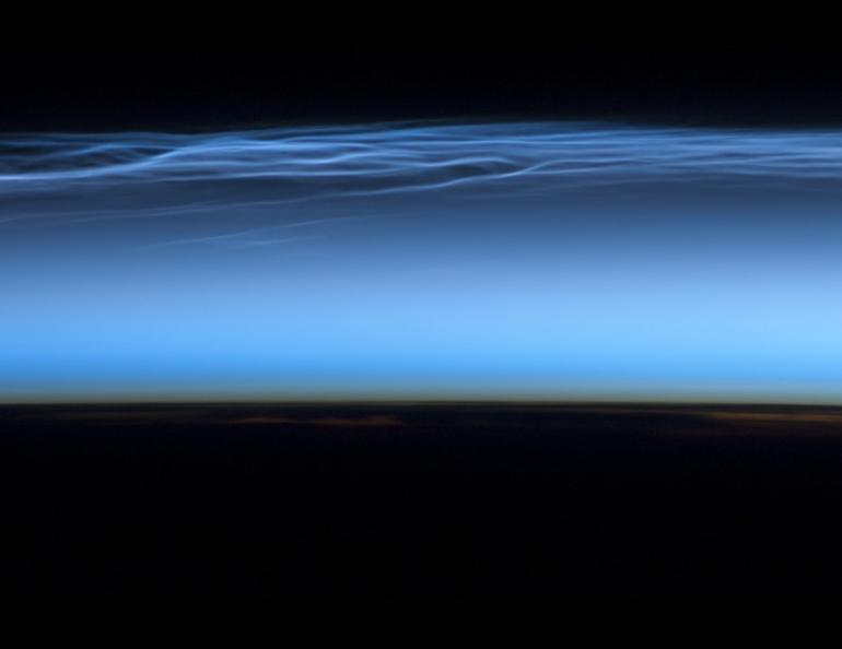 Polar mesospheric clouds appear above the Earth in this photograph by the Expedition 31 crew from the International Space Station on June 13, 2012. Photo by NASA's Johnson Space Center/International Space Station.