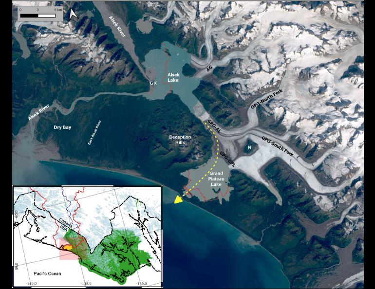 A satellite image showing the Alsek River and Grand Plateau Glacier in southern Alaska. The yellow dashed line represents where the Alsek River may soon flow due to extreme melting of Grand Plateau Glacier (labeled GPG). In the early 1900s, Alsek Glacier (AG) was connected to Grand Plateau Glacier.