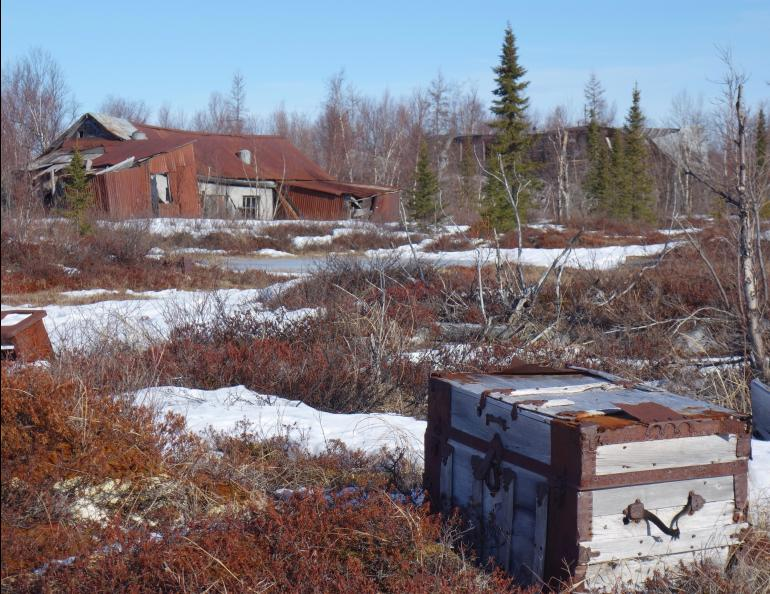 A travel trunk on the tundra in the ghost town of Iditarod. Photo by Ned Rozell.