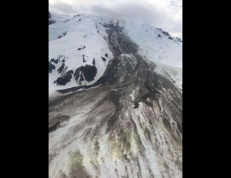 The June 2019 rock-and-ice avalanche down Red Glacier on Iliamna Volcano, taken on a flyover a few days later by Loren Prosser of Ninilchik. Photo by Loren Prosser, courtesy of Alaska Volcano Observatory.