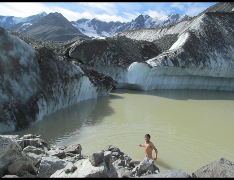 Glacier researcher Sam Herreid baths in a lake on Canwell Glacier in the eastern Alaska Range. Photo by Sam Herreid.