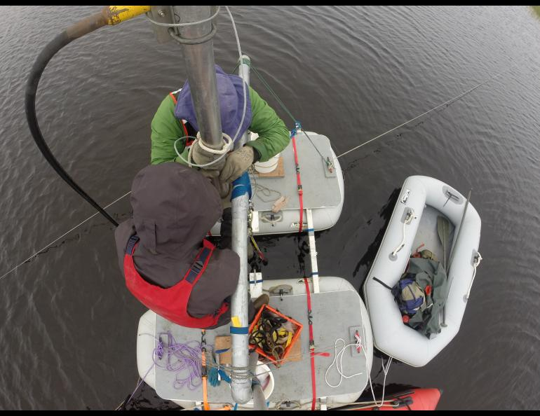 From above, Chris Maio (in green) and graduate student Reyce Bogardus pull a sediment core from a lake near Cape Espenberg. Chris Maio photo.