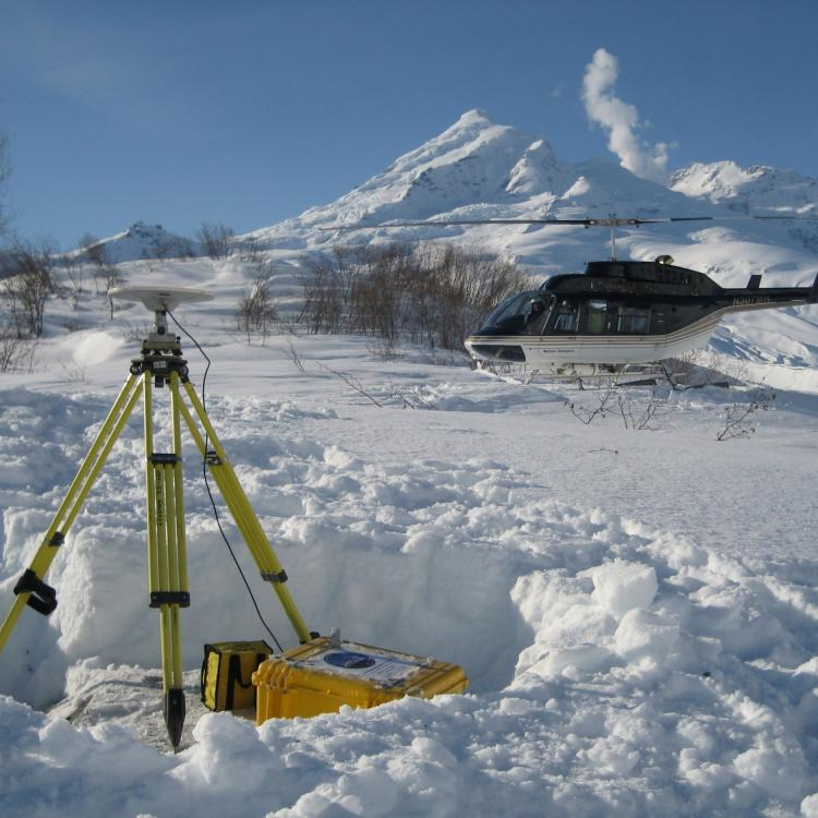 Survey of GPS station DUMM installed just before the 2009 Redoubt eruption. Photo by Max Kaufman, UAF-GI.