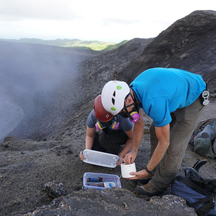GI researcher David Fee and graduate student Alex Iezzi deploy an infrasound sensor on the active Yasur Volcano, Vanuatu. Photo by Robin Matoza, University of California Santa Barbara.