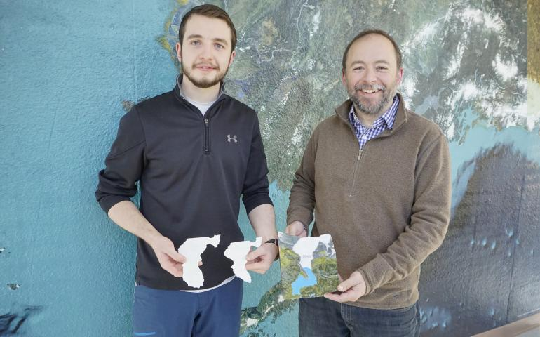 Reyce Bogardus, left, and Matthew Balazs pose with their 3D printed scale model representing the Mendenhall Glacier's ice volume at three points in history. UAF photo by Fritz Freudenberger.