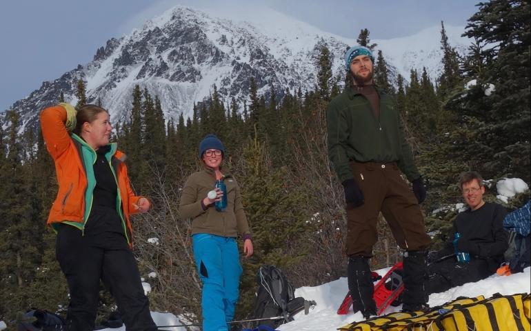 With Panorama Mountain in the background, from left, Lynn Kaluzienski, Elizabeth Berg, Cole Richards and Carl Tape take a break. Photo by Ned Rozell.