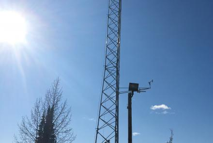 A meteorological tower owned and operated by the Alaska Climate Research Center monitors climate and weather in the Fairbanks area. The tower was acquired last fall and, this spring, will be able to monitor air quality thanks to a new Purple Air sensor installation. Photo by Telayna Wong.