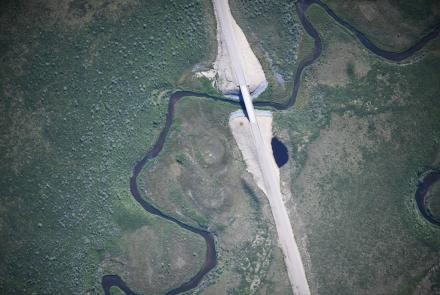 The SeaHunter unmanned aerial aircraft took several thousand high-resolution photographs of the new Inuvik–Tuktoyaktuk Highway in the Northwest Territories, Canada, such as this photo of the ITH crossing Zed Creek. Photo courtesy of Fisheries and Oceans Canada.