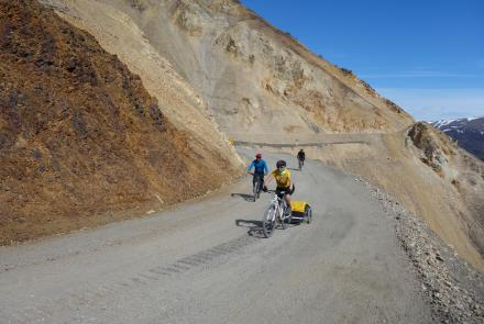 Cyclists ride an unstable portion of the 92-mile gravel road within Denali National Park. Photo by Ned Rozell.