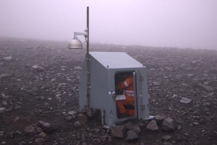 Guy Tytgat in a seismic-station hut near Pavlof Volcano in 2007. Alaska Volcano Observatory photo by Cyrus Read.