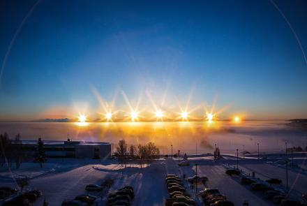 A multiple-exposure photo of the winter-solstice sun arcing over the Alaska Range, taken from the University of Alaska Fairbanks campus on Dec. 21, 2012. Photo by Todd Paris.