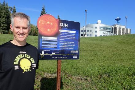 Space physics expert Peter Delamere at the start of the new UAF Planet Walk in Fairbanks. Photo by Ned Rozell.