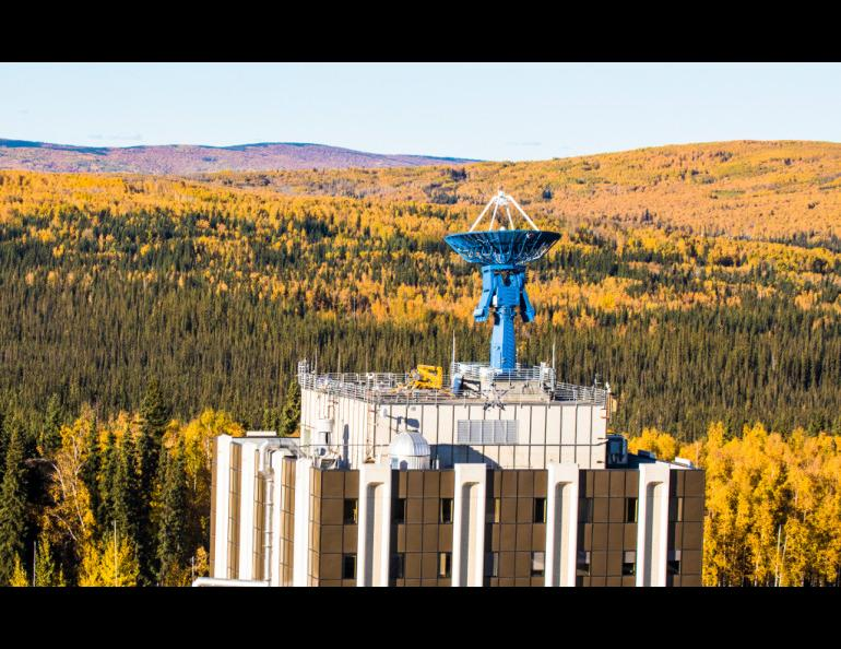 One of the Alaska Satellite Facility's antennas sits atop the Elvey Building, home of the University of Alaska Fairbanks Geophysical Institute. ASF uses its antennas to downlink data for NASA. UAF photo by JR Ancheta.